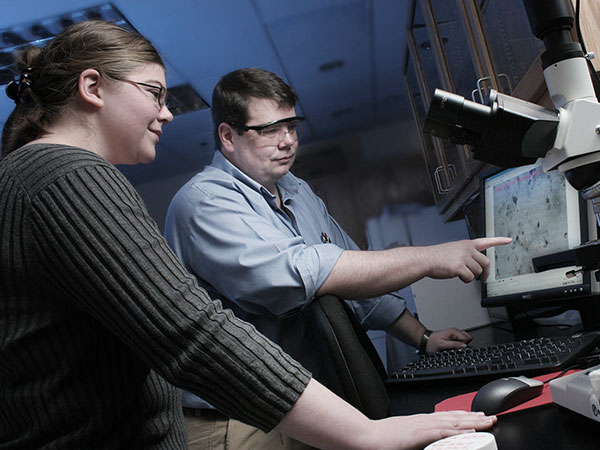 Faculty members conducting research